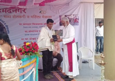 Fr. Siju felicitated by Bishop Lourdes